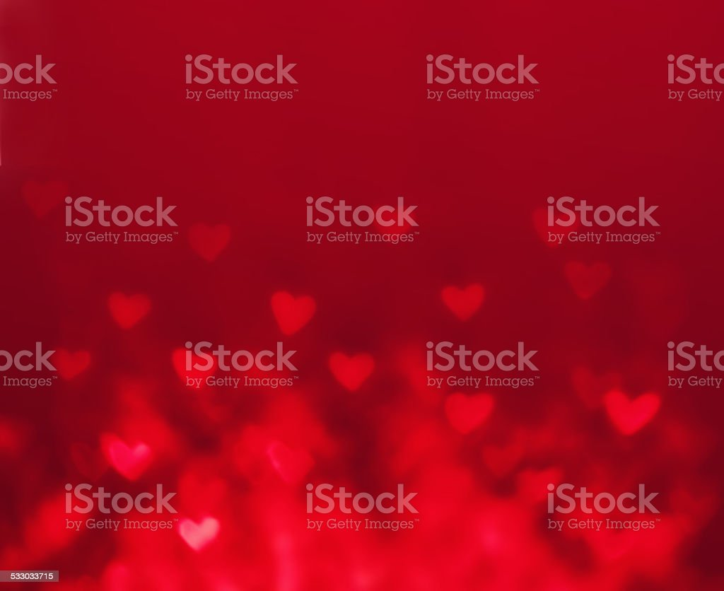 Abstract Valentine's day background with red hearts. Glow Colorf stock photo