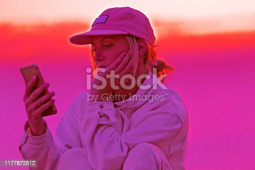 Abstract vibrant Pink background with girl holding cell phone