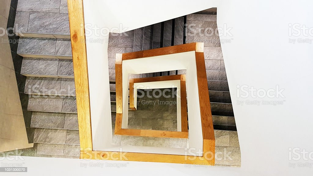 Abstract view down angular stone staircase stock photo
