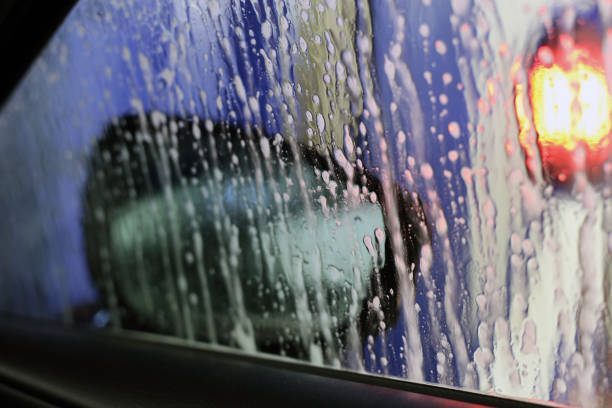 Abstract View from Inside a Car Being Washed - Water, Soap, etc. on a Car Window stock photo