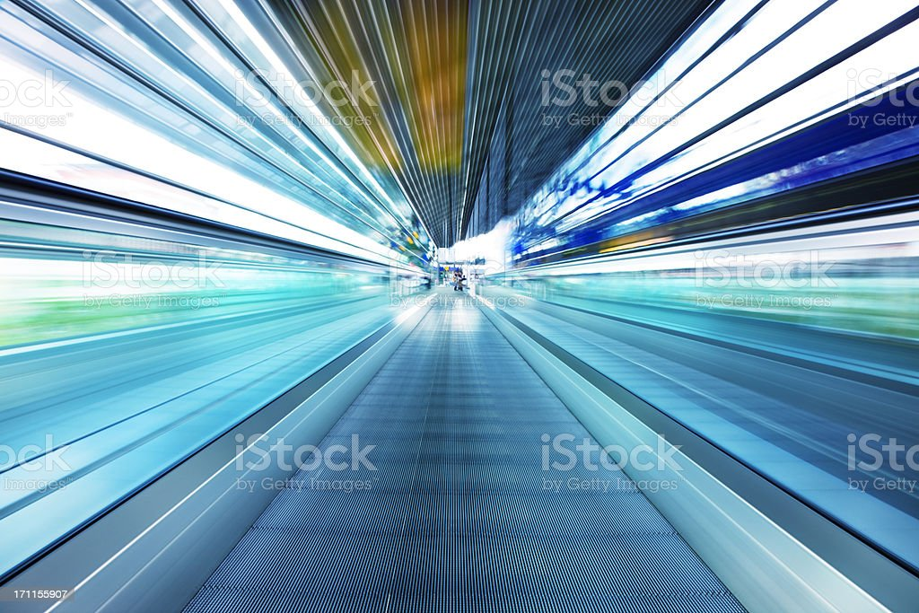 Abstract View of Moving Walkway in Airport Corridor stock photo