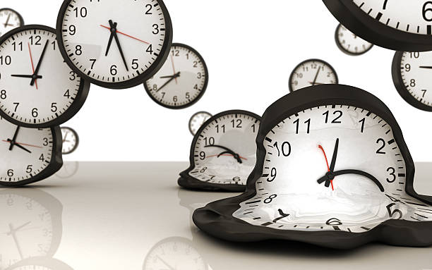 Abstract view of school room clocks melting away stock photo