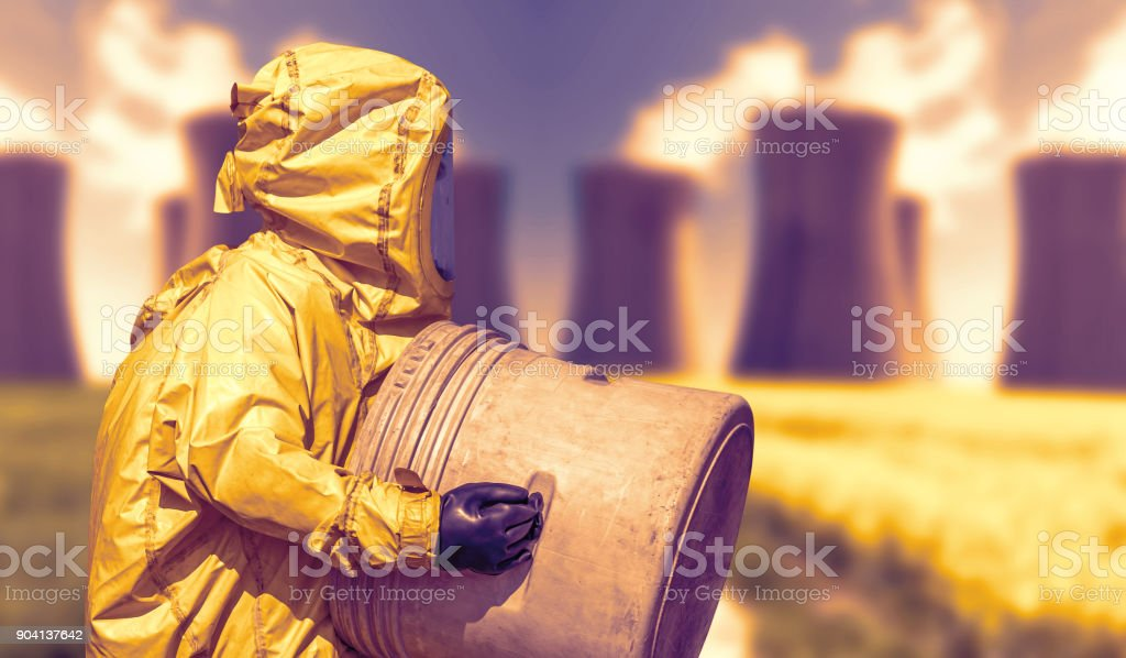 Abstract view of smoking coal power plant and men in protective hazmat suit stock photo