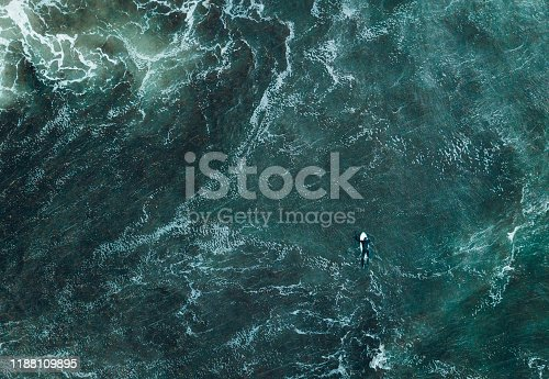 Top doen view of surfer in waves.