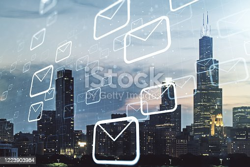 istock Abstract virtual postal envelopes illustration on Chicago skyline background. Email and communications concept. Multiexposure 1223903984