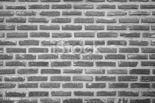 Abstract Wall black brick wall texture background pattern, brick surface backgrounds. Vintage Brickwork or stonework flooring interior rock old clean concrete grid uneven, wallpaper bricks design.