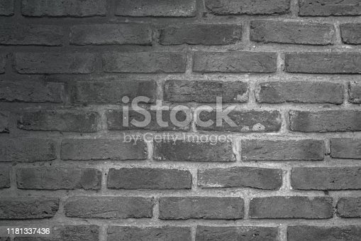 Abstract Wall black brick wall texture background pattern, brick surface backgrounds. Vintage Brickwork or stonework flooring interior rock old clean concrete grid uneven, wallpaper bricks design.
