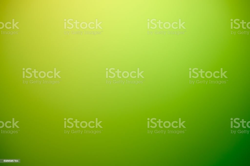 Abstract warm blurred green gradient background from white to green stock photo