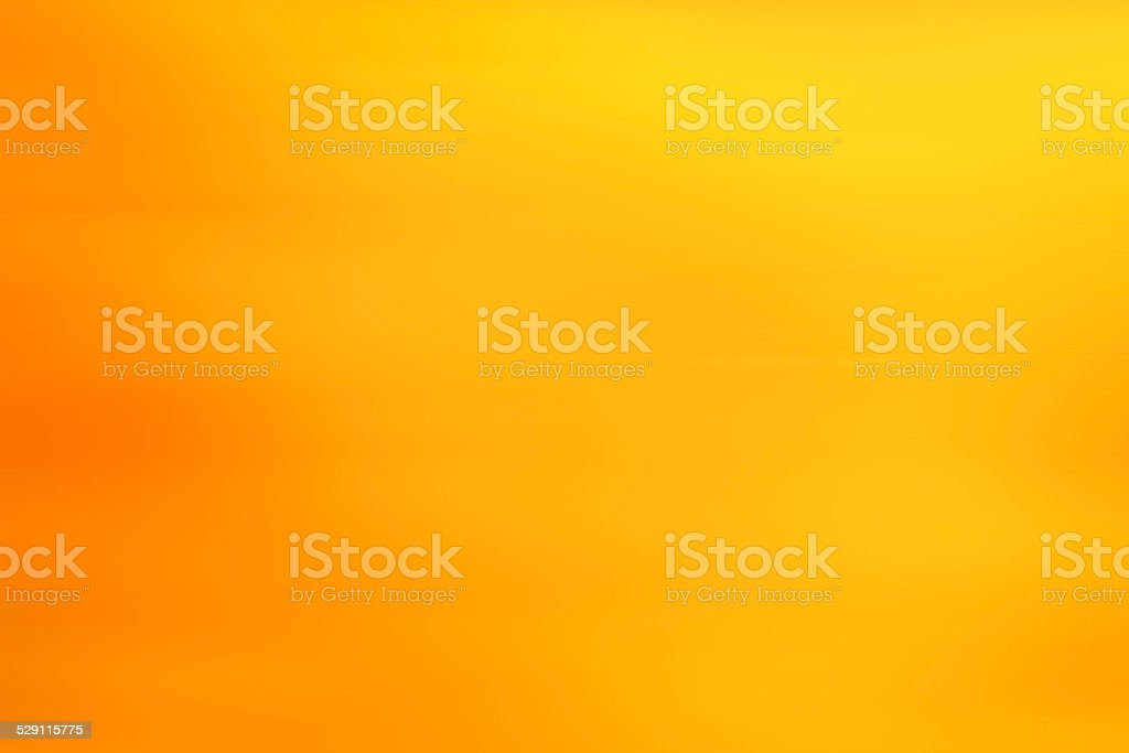 abstract warm yellow background motion blur stock photo