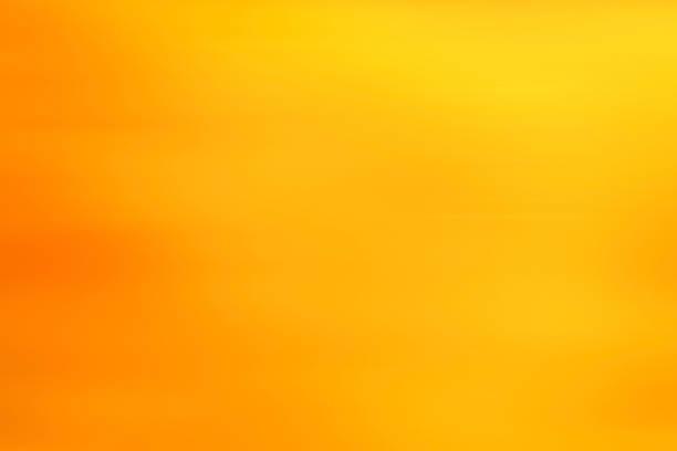 Fondo abstracto amarillo en movimiento borroso cálido - foto de stock