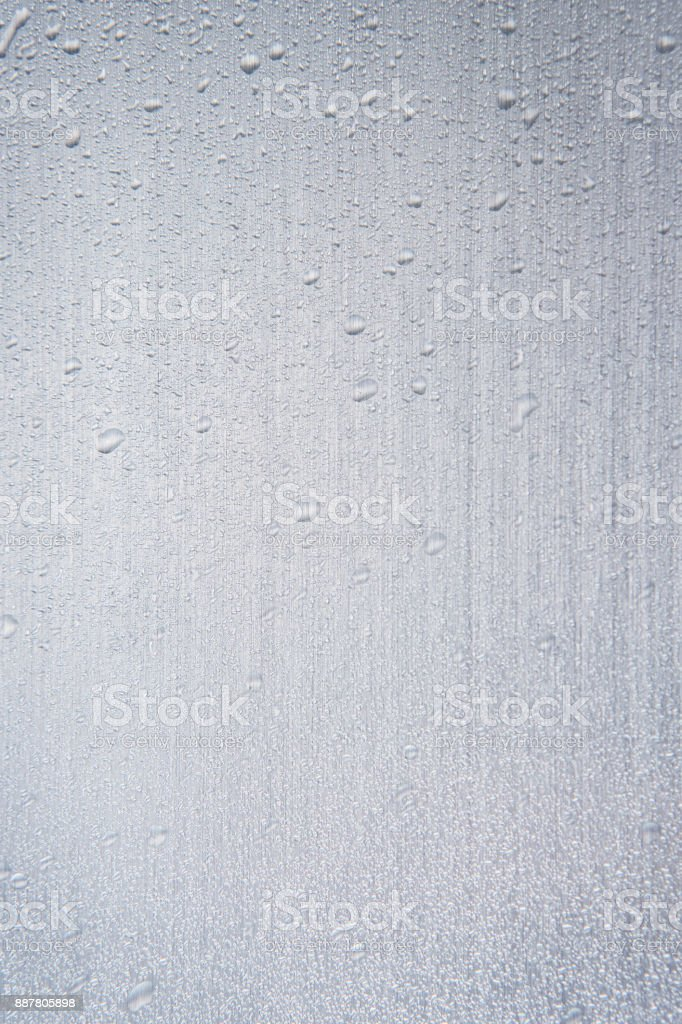 Abstract water drops on a silver background. stock photo