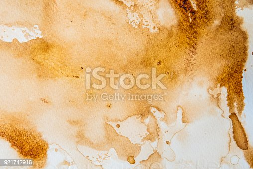 istock abstract watercolor backgrounds by use coffee painted on paper 921742916