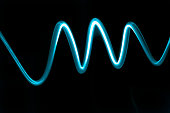 Abstract wave of electric neon blue light on a dark background Simple and modern design