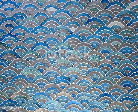 Blue ceramic tile mosaic seamless wave pattern texture background.