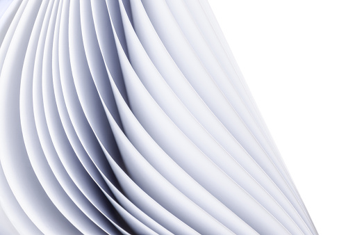 Abstract waves. Close-up of slightly bent stack of paper (shallow DOF)