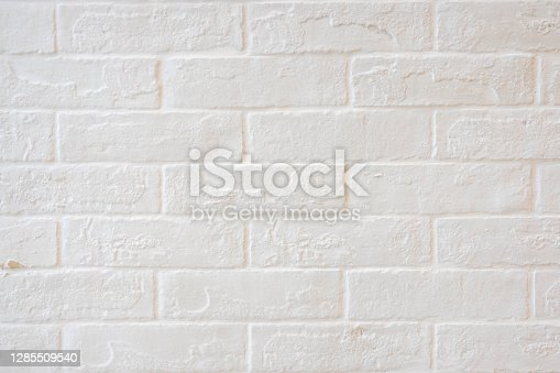 Abstract weathered textured white brick wall background. Brickwork stonework interior, rock old clean concrete grid uneven, horizontal architecture wallpaper.