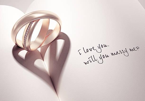 3 d abstrakt hochzeit ringe mit heartshadow auf einem buch mitte - heiratsantragsring stock-fotos und bilder