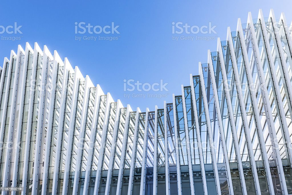 Abstract White Architecture Building on Clear Blue Sky stock photo