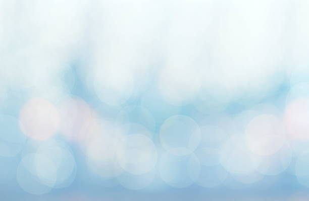Abstract white blue and pink colors blurred bokeh light stock photo