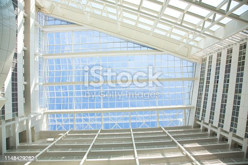 istock Abstract white building transparent interior glass ceiling rooftop background. 1148429282