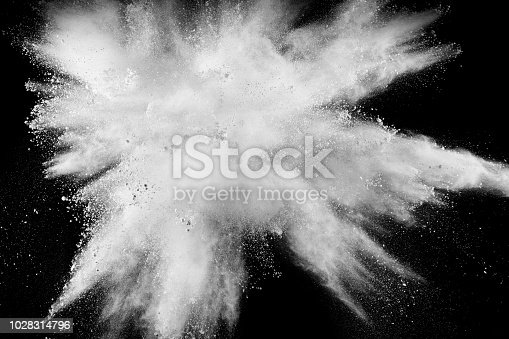 930861094istockphoto Abstract white powder explosion against black background. 1028314796