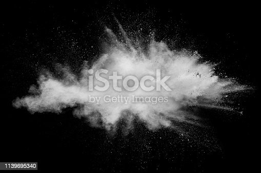 istock Abstract white powder explosion against black background.White dust exhale in the air. 1139695340