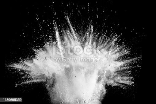 istock Abstract white powder explosion against black background.White dust exhale in the air. 1139695359