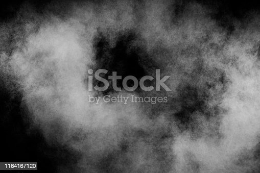istock Abstract white powder explosion against black background.White dust cloud in the air. 1164167120