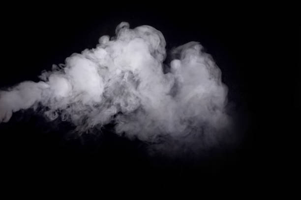 Abstract white smoke against dark background stock photo
