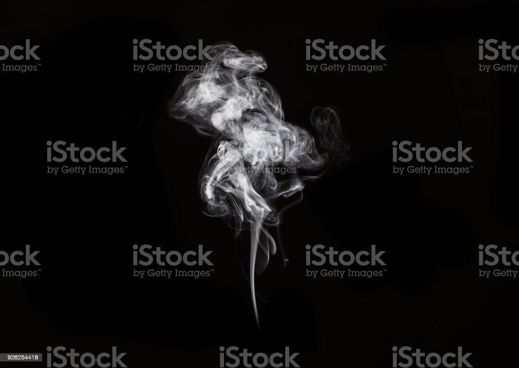 abstract white smoke in dark background. stock photo
