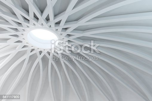 istock Abstract white structure with sunlight coming from dome hole 541117920