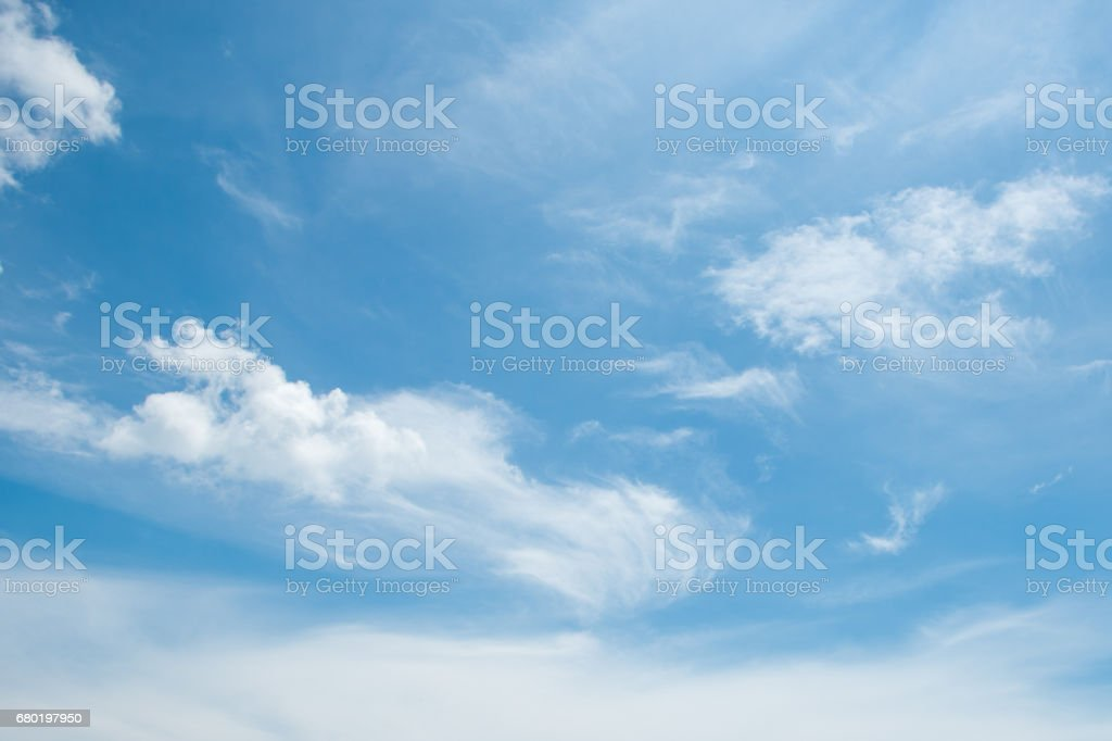 abstract white wispy clouds and blue sky in sunny day of summer season stock photo