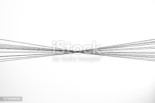 Monochrome abstract expressive wool wire forming patterns on a white background.
