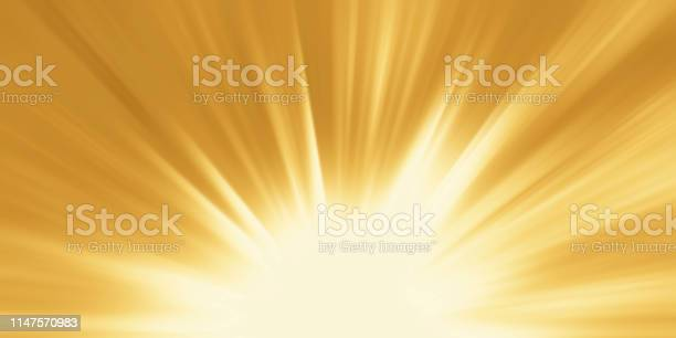 Photo of Abstract yellow background. Magic light with gold burst