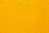 Abstract painted background. Background was painted with yellow orange oil color on canvas by hand.