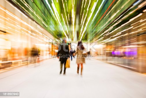 istock Abstracted image of young couple in mall 181892940
