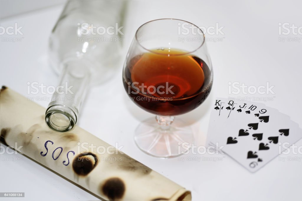 Abstraction of drinking and playing cards. stock photo
