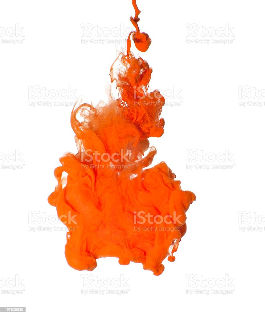 Abstraction of orange acrylic paint in water. stock photo