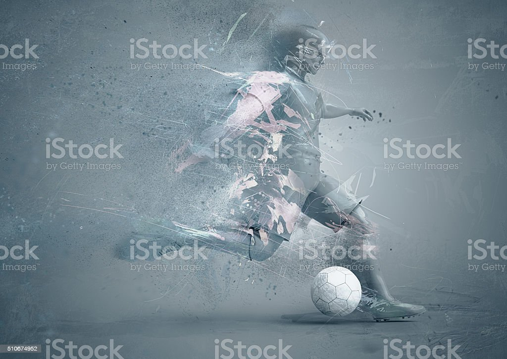 abstrct soccer player delivering a power kick stock photo