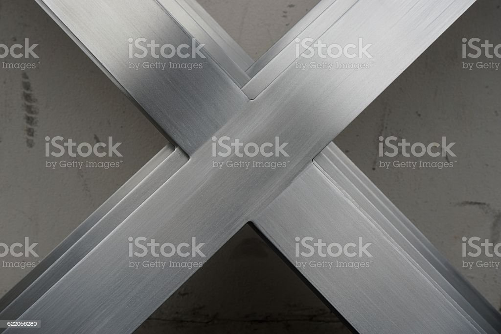 abtract metal x shape stock photo