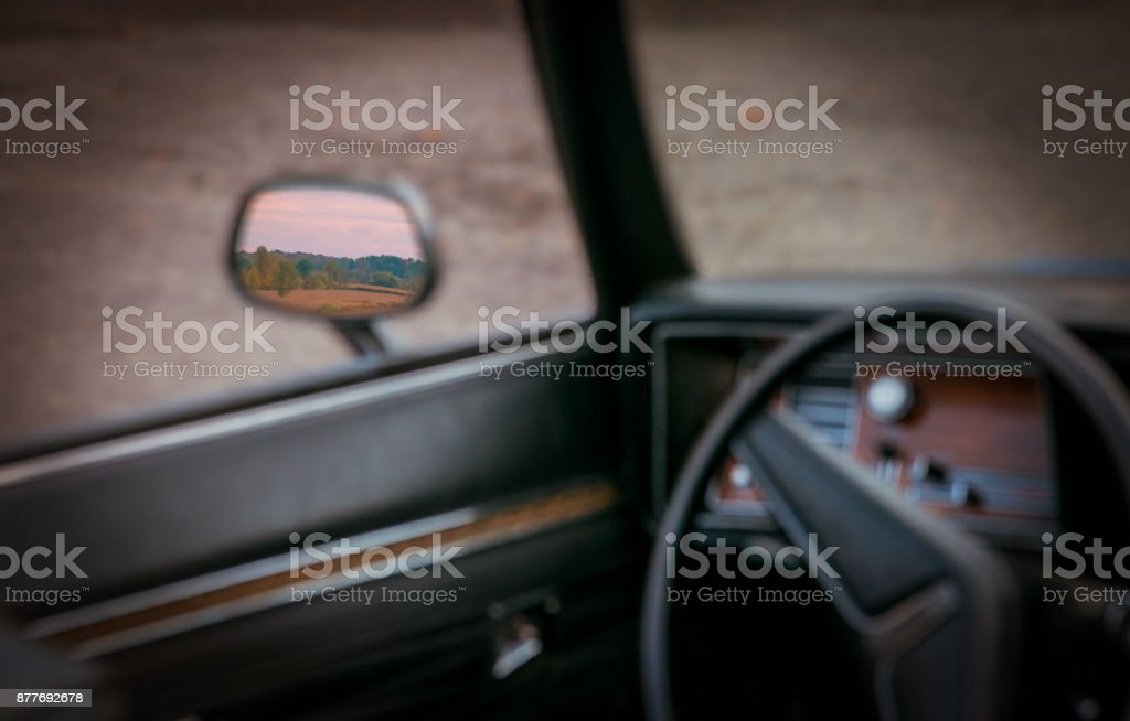 Abtract side view mirror shot of an old 1971 car stock photo