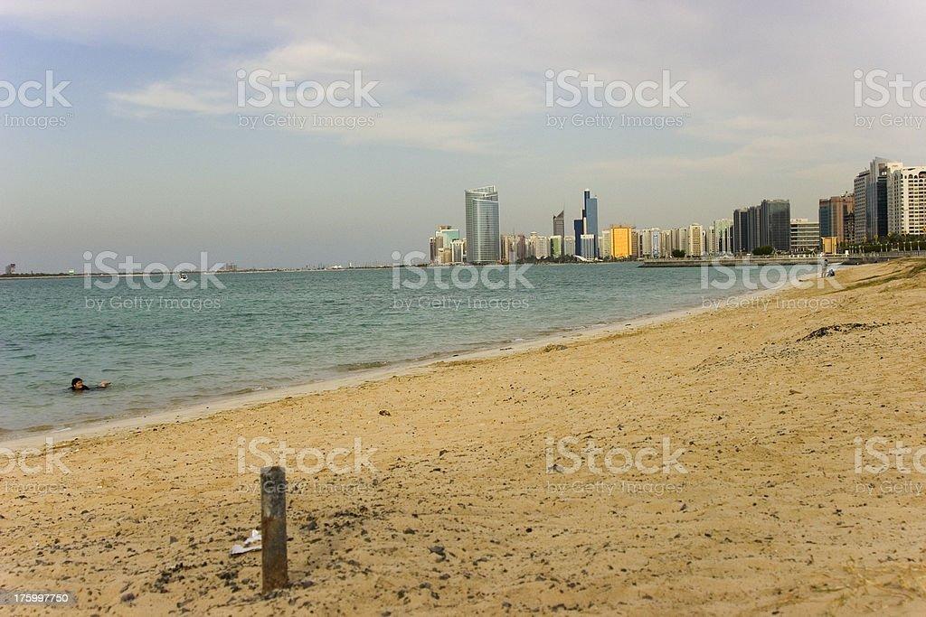 Abu Dhabi skyline and bathing girl 16314 royalty-free stock photo
