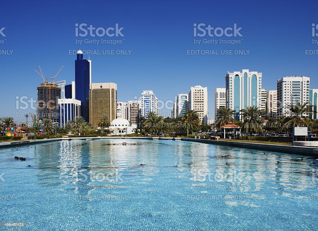 Abu Dhabi skyline reflects on the fountain of Corniche stock photo