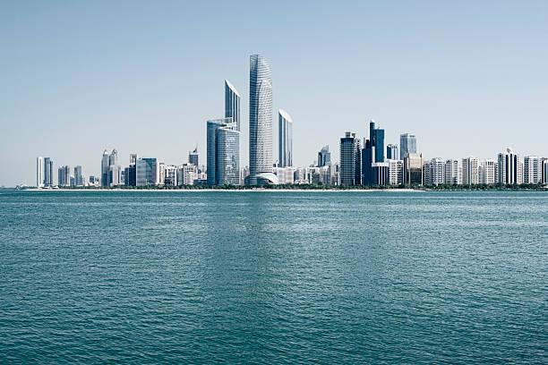 abu dhabi skyline, united arab emirates - abu dhabi stok fotoğraflar ve resimler