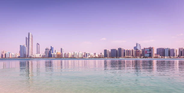 Abu Dhabi Skyline with skyscrapers with water stock photo