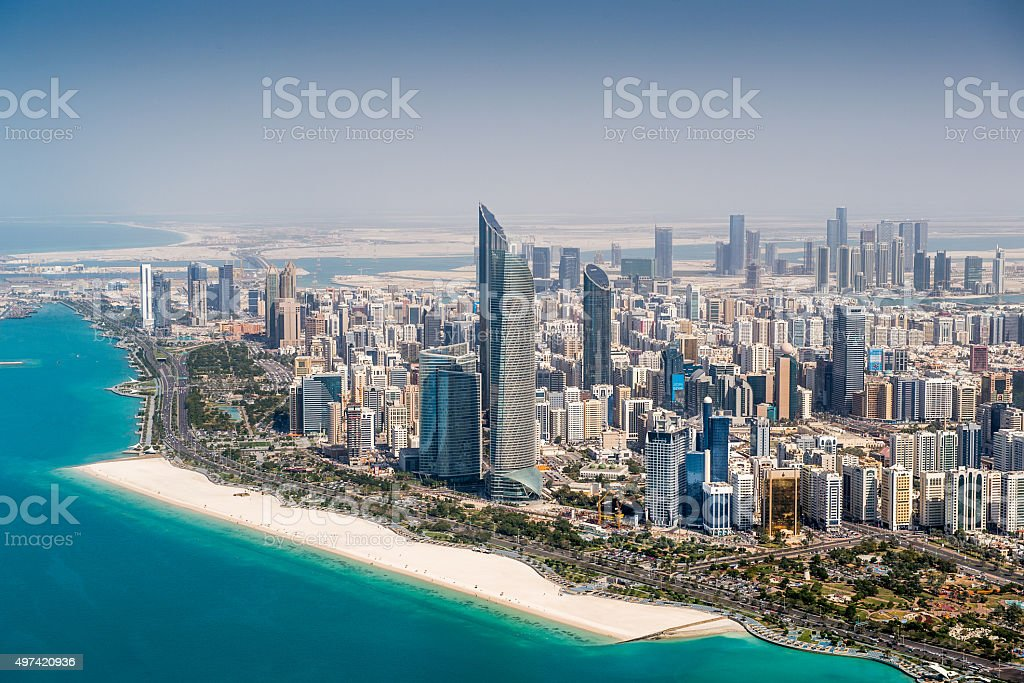 Abu Dhabi skyscrapers viewed from the sky Part of Abu Dhabi, UAE with surrounding area wiewed from helicopter. Many details are visible in the image. 2015 Stock Photo