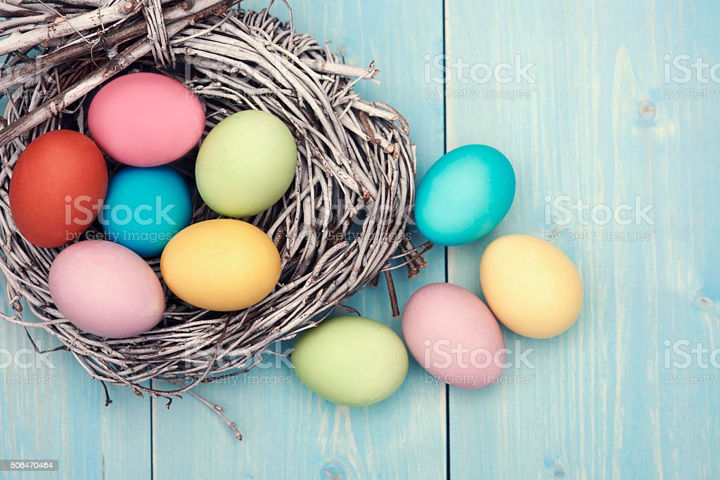 Abundance of colorful easter eggs on the table stock photo