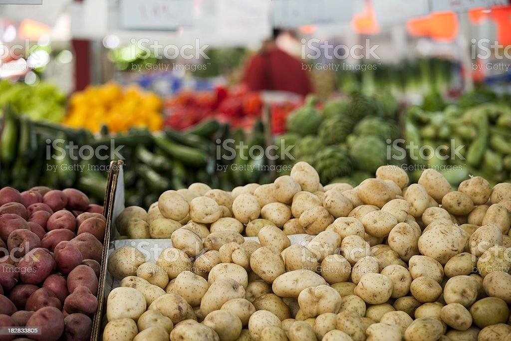Abundant fresh potatoes at a farmers market stock photo