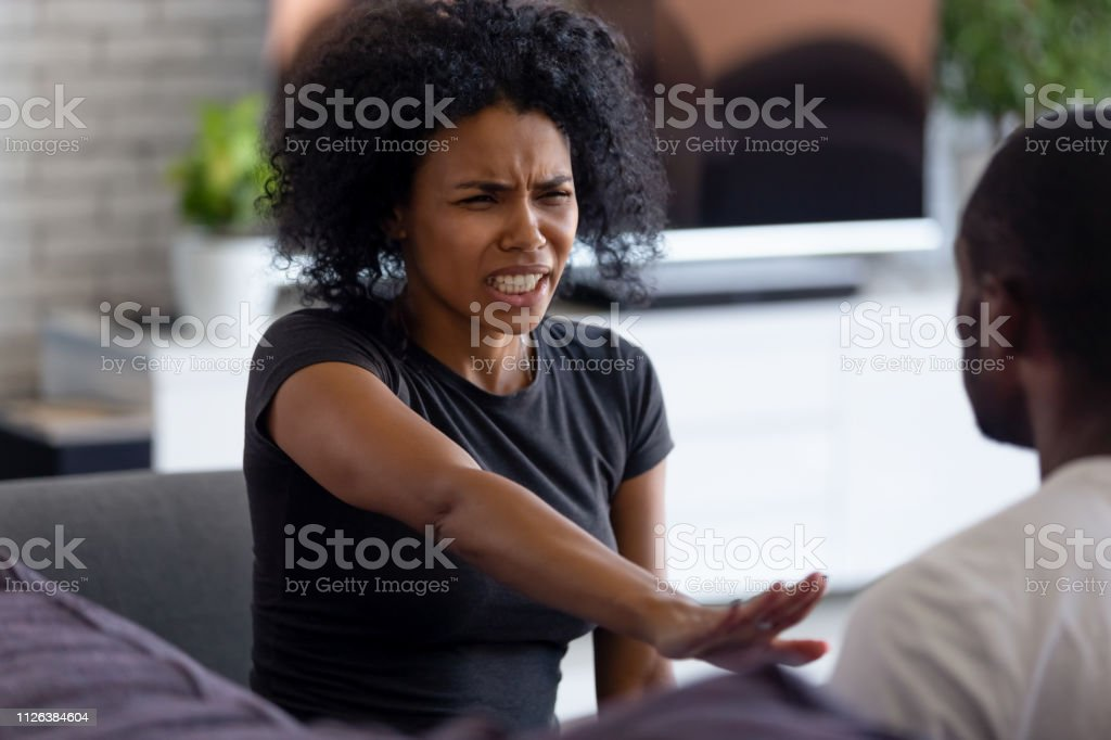 Abused scared african wife shows stop enough violence hand gesture stock photo