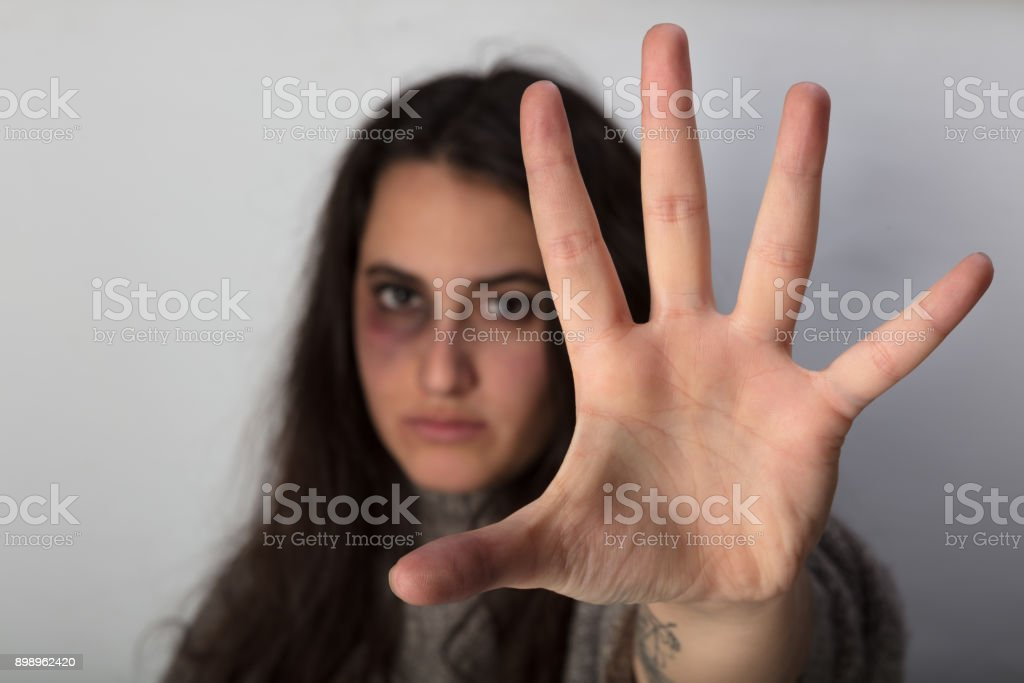 Abused woman stretching out her spread hand stock photo